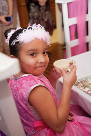 Juice poured in real tea cups by the Sugar Plum Fairy. / 2012