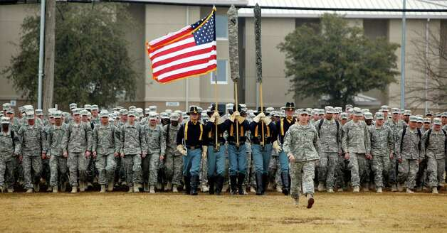 U.S. Army 1st Cavalry 3rd Brigade soldiers march onto the parade grounds upon their return home from deployment in Iraq,at Fort Hood, Texas. These 3rd Brigade troops were in the last convoy to leave Iraq. Once home, veterans face a big backlog for veterans to obtain disability benefits. Nationally, there are 817,696 claims pending, and nearly 72 percent (588,011) are backlogged with an average wait time of about nine months, figures show Photo: Erich Schlegel, Associated Press / FR 62355 AP