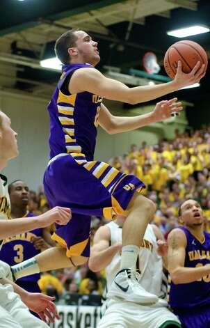 Albany's Peter Hooley drives to the basket against Vermont during their championship NCAA college basketball game in the America East Conference tournament, Saturday, March 16, 2013, in Burlington, Vt. Photo: Glenn Russell, Glenn Russell / AP Photo/The Burlington Free Press / The Burlington Free Press