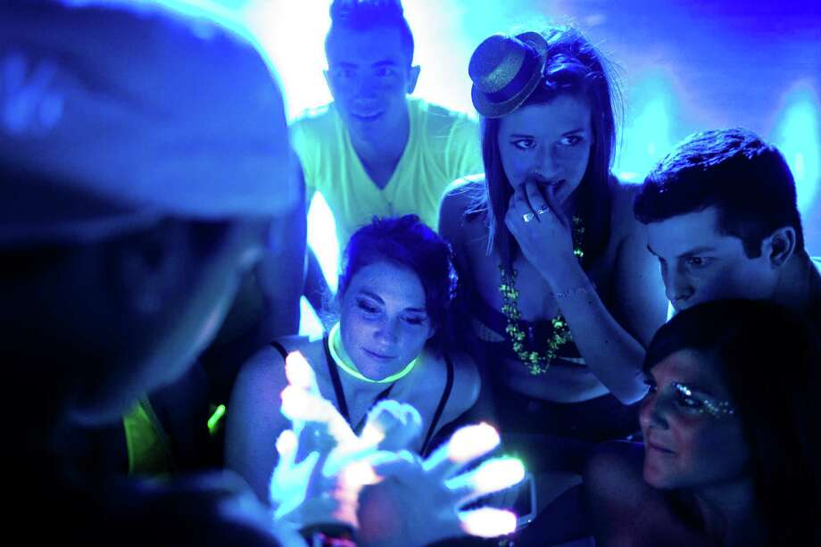 A crowd of attendees enjoy an LED glove light show at Lucky 2013. Photo: JORDAN STEAD / SEATTLEPI.COM