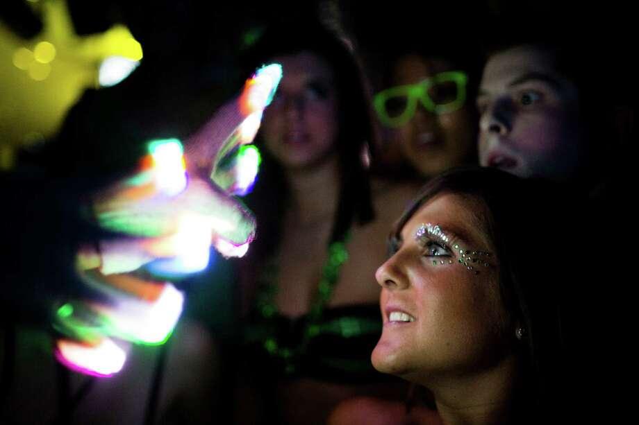 A crowd of attendees enjoy an LED glove light show at Lucky 2013. Photo: JORDAN STEAD / SEATTLEPI.COM
