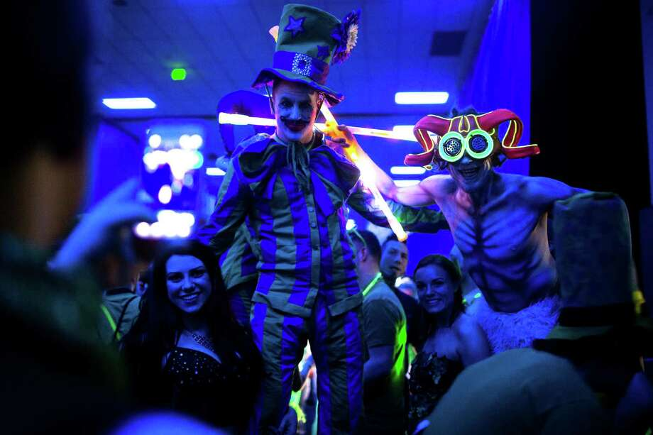 Stilted and costumed performers pose for pictures at Lucky 2013. Photo: JORDAN STEAD / SEATTLEPI.COM