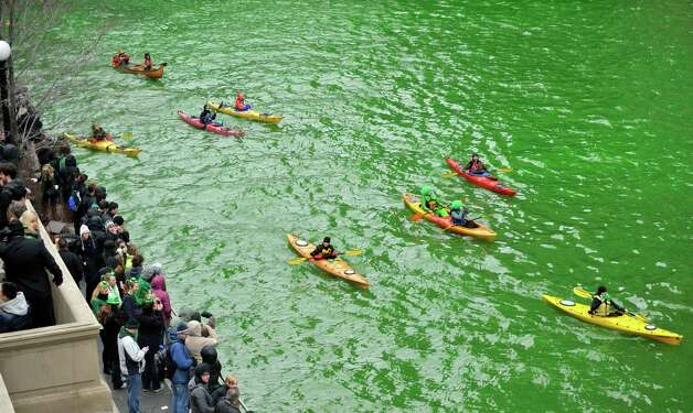 Spectators watch as the Chicago River is dyed green right before the start of the St. Patrick's Day parade in Chicago, Saturday, March, 16, 2013.  With the holiday itself falling on a Sunday, many celebrations were scheduled instead for Saturday because of religious observances. Photo: Paul Beaty