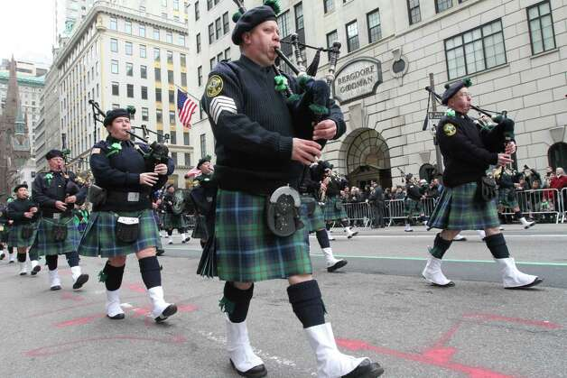 The Breezy Point Catholic Club Pipes and Drums, from the Queens borough of New York, make their way up New York's Fifth Avenue as they take part in the St. Patrick's Day Parade Saturday March 16, 2013. Photo: Tina Fineberg