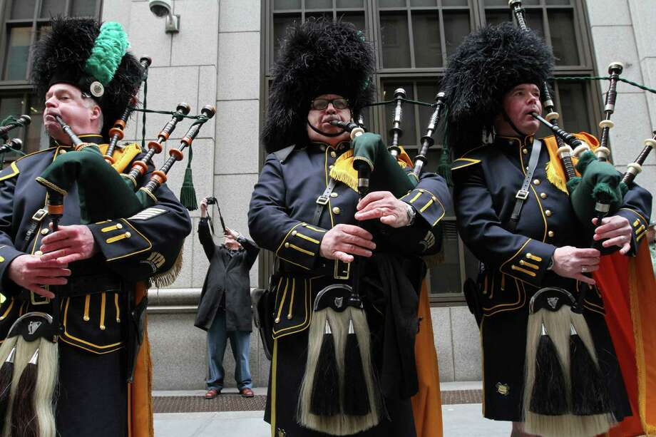 John Sanford, foreground center, and other members of the New York City Police Department Pipes and Drums practice before the start of the St. Patrick's Day Parade, Saturday March 16, 2013 in New York. Photo: Tina Fineberg