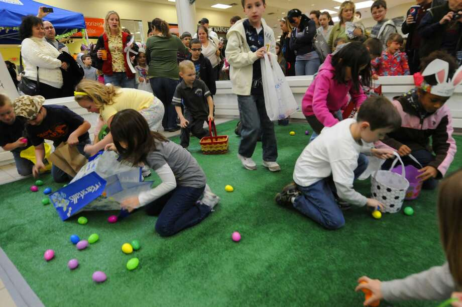 Children scramble for plastic eggs filled with candy during the Clifton Park Center Easter egg hunt in Clifton Park, NY Saturday April 16,2011. ( Michael P. Farrell/Times Union ) Photo: Michael P. Farrell / 00012782A