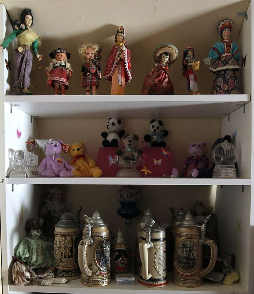 Dolls And Beer Steins Fill Shelves In Melodie Cheneys Home At The Buena Vista Trailer Park