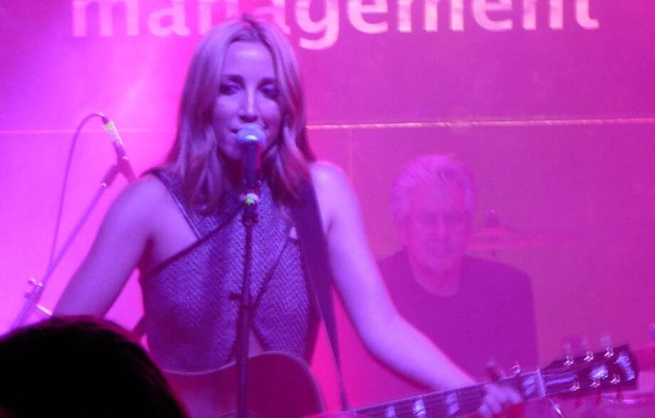 """Ashley Monroe, one third of the trio Pistol Annies, sings songs from her new solo CD """"Like a Rose"""" at Vice on Sixth Street on Friday night. Photo: Jim Kiest / San Antonio Express-News"""