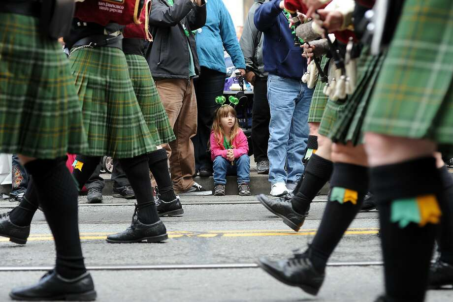 Ashley Johnson, 4, visiting from Sonoma with her family, sits on the curb as she watches the parade go by.  The annual St. Patrick's Day Parade in San Francisco, Saturday March 16th, 2013. Photo: Michael Short, Special To The Chronicle
