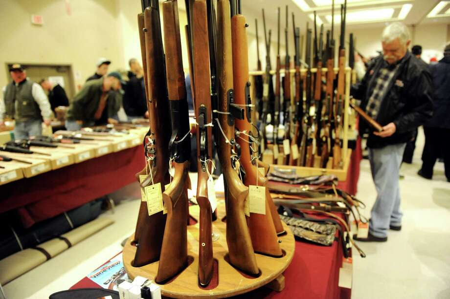 Rifles for sale during the Arms Fair on Saturday, March 16, 2013, at the City Center in Saratoga Springs, N.Y. The New Eastcoast Arms Collectors Associates sponsored the event. (Cindy Schultz / Times Union) Photo: Cindy Schultz / 00021578A