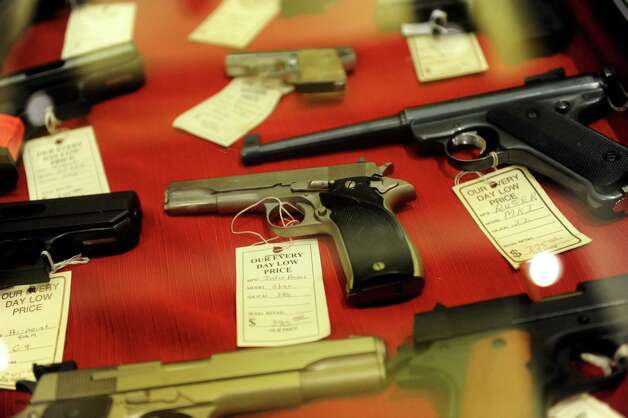 Hand guns for sale during the Arms Fair on Saturday, March 16, 2013, at the City Center in Saratoga Springs, N.Y. The New Eastcoast Arms Collectors Associates sponsored the event. (Cindy Schultz / Times Union) Photo: Cindy Schultz / 00021578A