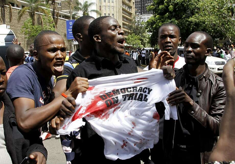 Supporters of Kenya's Prime Minister Raila Odinga protest outside the Supreme Court as a case is filed over claims of massive fraud that took place during the country's March 4 election, in Nairobi, Kenya, Saturday, March 16, 2013. Uhuru Kenyatta won the election with 50.07 percent of the vote. Saturday is the last day Odinga can file a petition to protest the result. Kenya's election has been largely peaceful, unlike the 2007 vote that sparked two months of violence that killed more than 1,000 people. (AP Photo/Khalil Senosi) Photo: Khalil Senosi, Associated Press