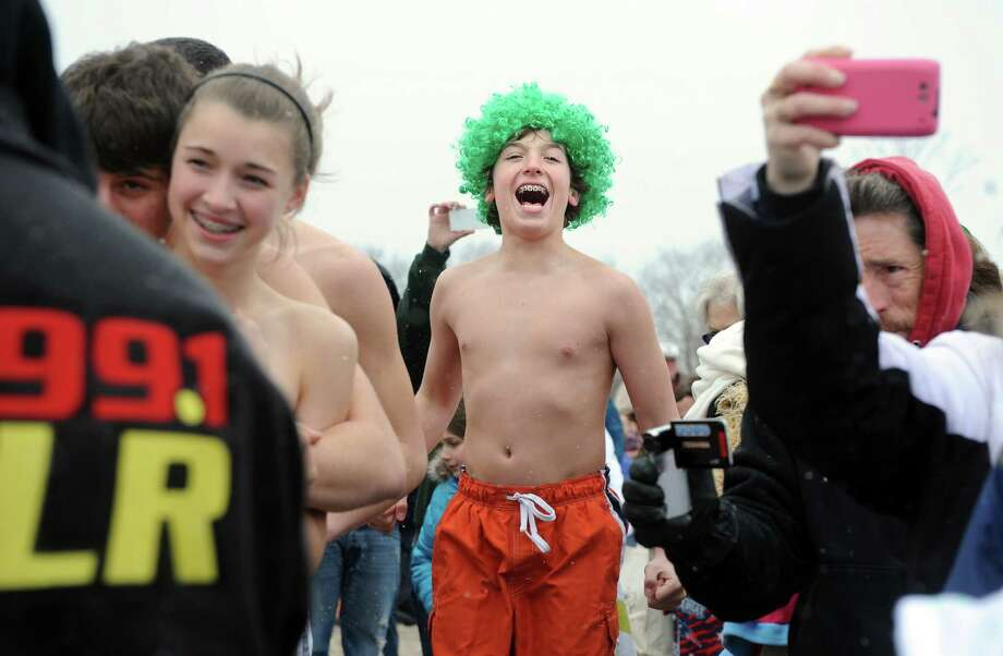 J.D. Anderson, 13, of Milford, gets ready to charge into the water during the annual Leprechaun Leap to benefit the Literacy Center of Milford Saturday, Mar. 16, 2013 at Walnut Beach in Milford, Conn. Photo: Autumn Driscoll / Connecticut Post