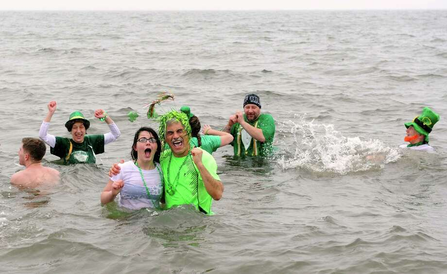 Nick Mongillo, a Shelton pediatrician, and Morgan Willets, of Shelton, one of his patients, stand in the icy water during the annual Leprechaun Leap to benefit the Literacy Center of Milford Saturday, Mar. 16, 2013 at Walnut Beach in Milford, Conn. Photo: Autumn Driscoll / Connecticut Post