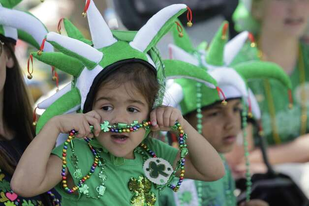Gia Pearce, 4, and her brother, Dominic Pearce, 7, watch the 54th annual Houston St. Patrick's Day Parade Saturday, March 16, 2013, in Houston. Photo: Melissa Phillip, Houston Chronicle / © 2013  Houston Chronicle