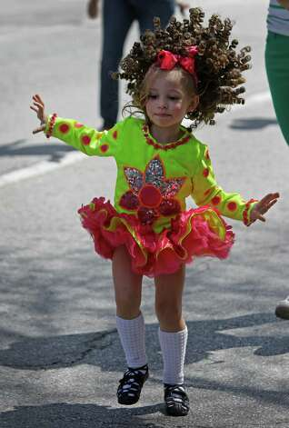 Adley Olson with the Cass-Barrington Academy of Irish Dance performs during the 54th annual Houston St. Patrick's Day Parade Saturday, March 16, 2013, in Houston. Photo: Melissa Phillip, Houston Chronicle / © 2013  Houston Chronicle