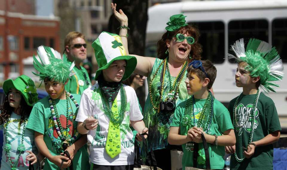 Spectators line the streets during the 54th annual Houston St. Patrick's Day Parade Saturday, March