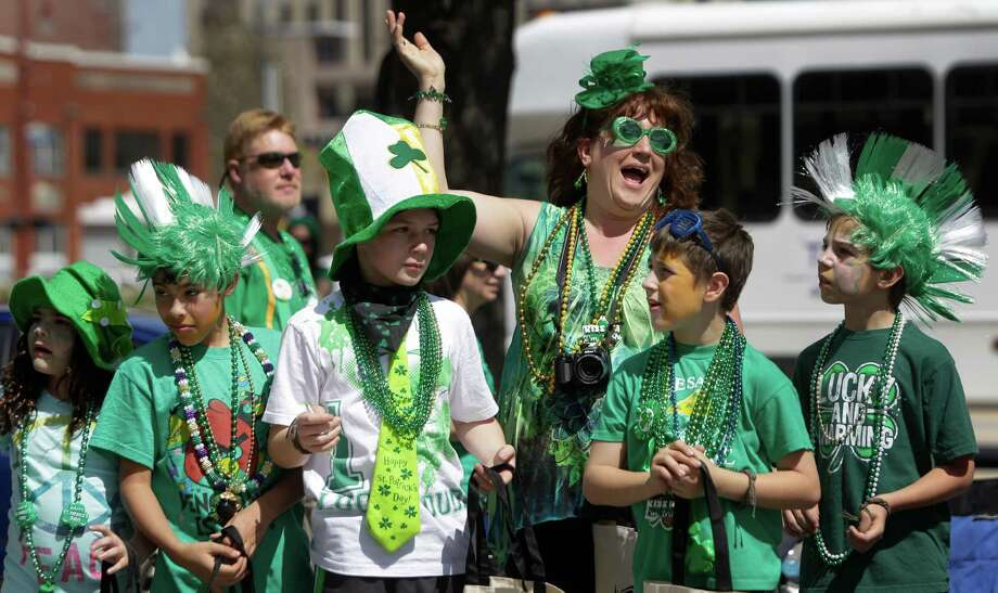 Spectators line the streets during the 54th annual Houston St. Patrick's Day Parade Saturday, March 16, 2013, in Houston. Photo: Melissa Phillip, Houston Chronicle / © 2013  Houston Chronicle