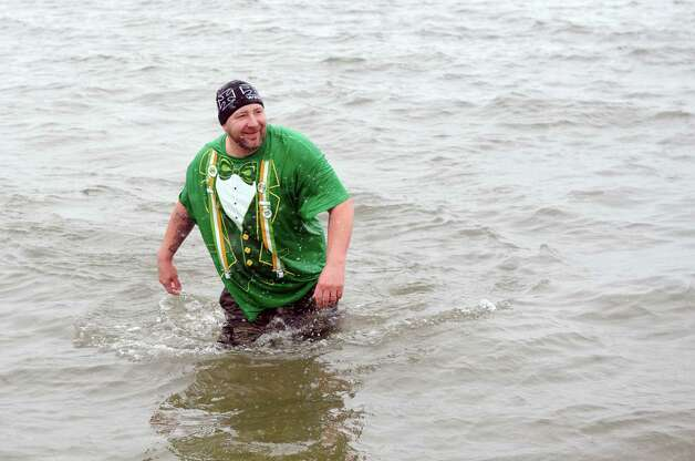 Last-man-standing John Willets, of Shelton, finally exits the water during the annual Leprechaun Leap to benefit the Literacy Center of Milford Saturday, Mar. 16, 2013 at Walnut Beach in Milford, Conn. Photo: Autumn Driscoll / Connecticut Post