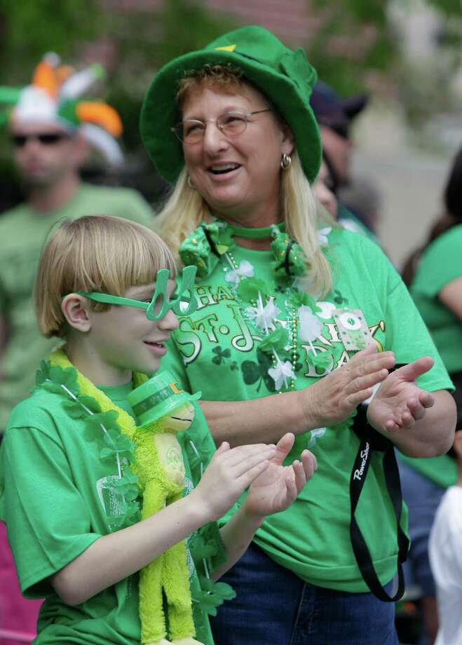 Sharon McCauley of Waco and her son, Travis McCauley watch the 54th annual Houston St. Patrick's Day Parade Saturday, March 16, 2013, in Houston. Photo: Melissa Phillip, Houston Chronicle / © 2013  Houston Chronicle