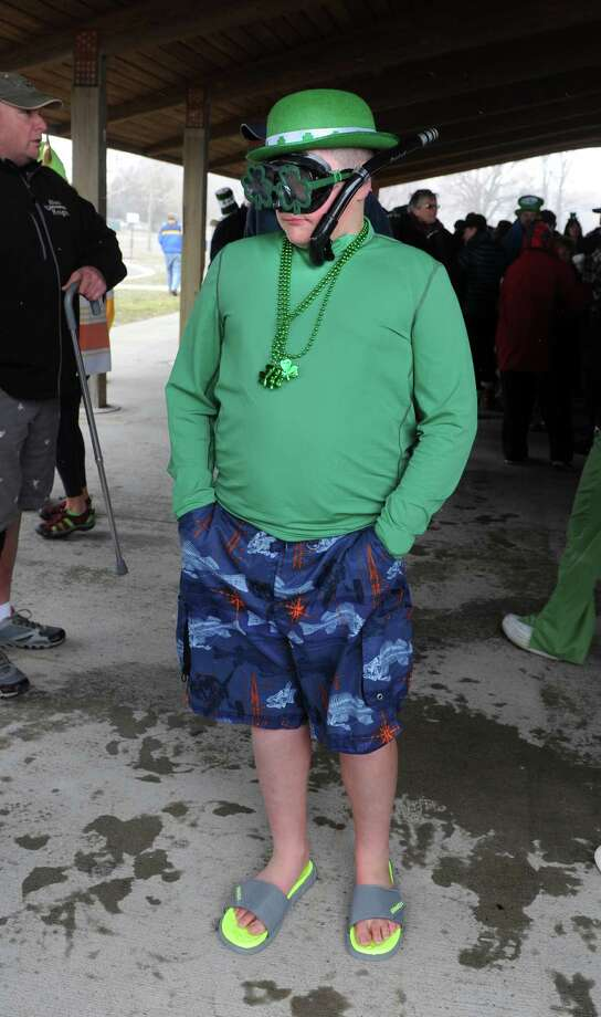 Brandon DiCicco, 13, of Milford, waits for the start of the annual Leprechaun Leap to benefit the Literacy Center of Milford Saturday, Mar. 16, 2013 at Walnut Beach in Milford, Conn. Photo: Autumn Driscoll / Connecticut Post