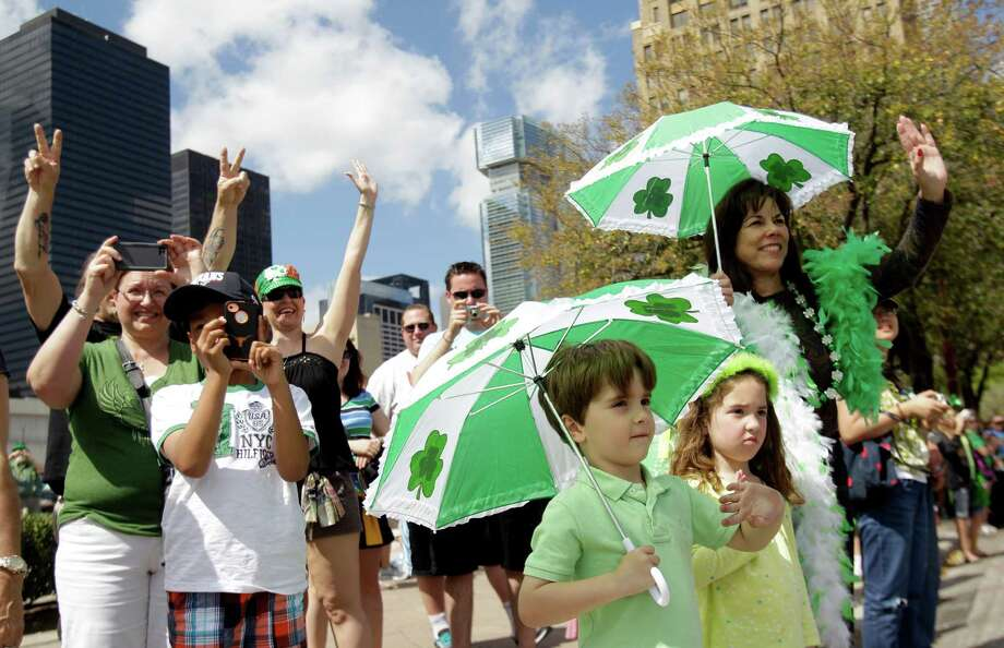 Cannone Granello, 4, center, and his twin sister, Isabella Granello watch with their grandmother, Cathey Granello, right,  of Houston during the 54th annual Houston St. Patrick's Day Parade Saturday, March 16, 2013, in Houston. Photo: Melissa Phillip, Houston Chronicle / © 2013  Houston Chronicle