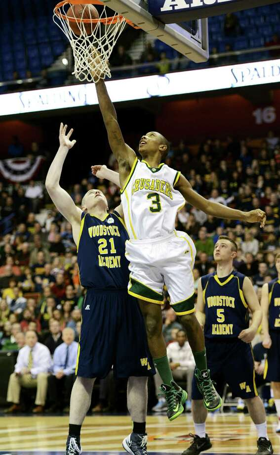 Trinity Catholic's Tremaine Frasier goes up for a basket over Sullivan Gardner of Woodstock Academy in the CIAC class L boys basketball championship game at Mohegan Sun Arena in Uncasville, Conn. on Saturday, March 16, 2013. Photo: Mark Conrad / Stamford Advocate Freelance