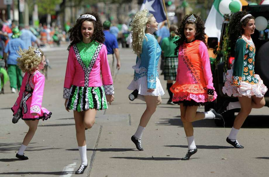 Members of the Cass-Barrington Academy of Irish Dance perform during the 54th annual Houston St. Patrick's Day Parade Saturday, March 16, 2013, in Houston. Photo: Melissa Phillip, Houston Chronicle / © 2013  Houston Chronicle