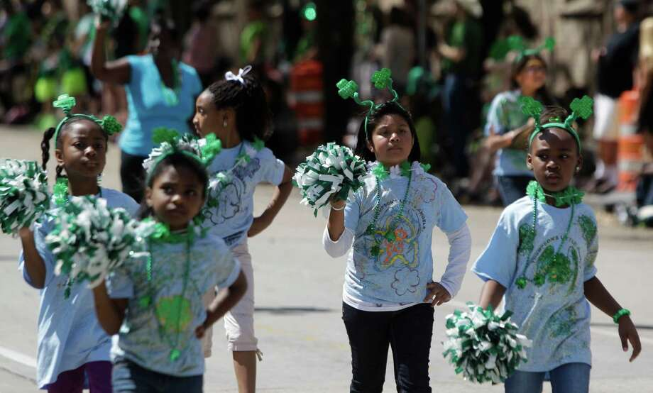 Student from Ruby L. Thompson Elementary School march in the 54th annual Houston St. Patrick's Day Parade Saturday, March 16, 2013, in Houston. Photo: Melissa Phillip, Houston Chronicle / © 2013  Houston Chronicle