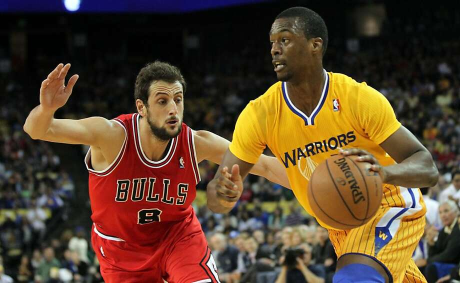 Golden State Warriors forward Harrison Barnes (40) drives past Chicago Bulls defenders in the first half of their NBA basketball game Friday, March 15, 2013, in Oakland Calif. Photo: Lance Iversen, The Chronicle