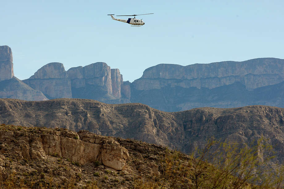 Customs and Border Protection Commissioner Alan Bersin flies over the international crossing at Boquillas in Big Bend National Park on a 2010 visit. The border crossing in the remote area soon will be automated. Photo: JERRY LARA, SAEN Staff / San Antonio Express-News