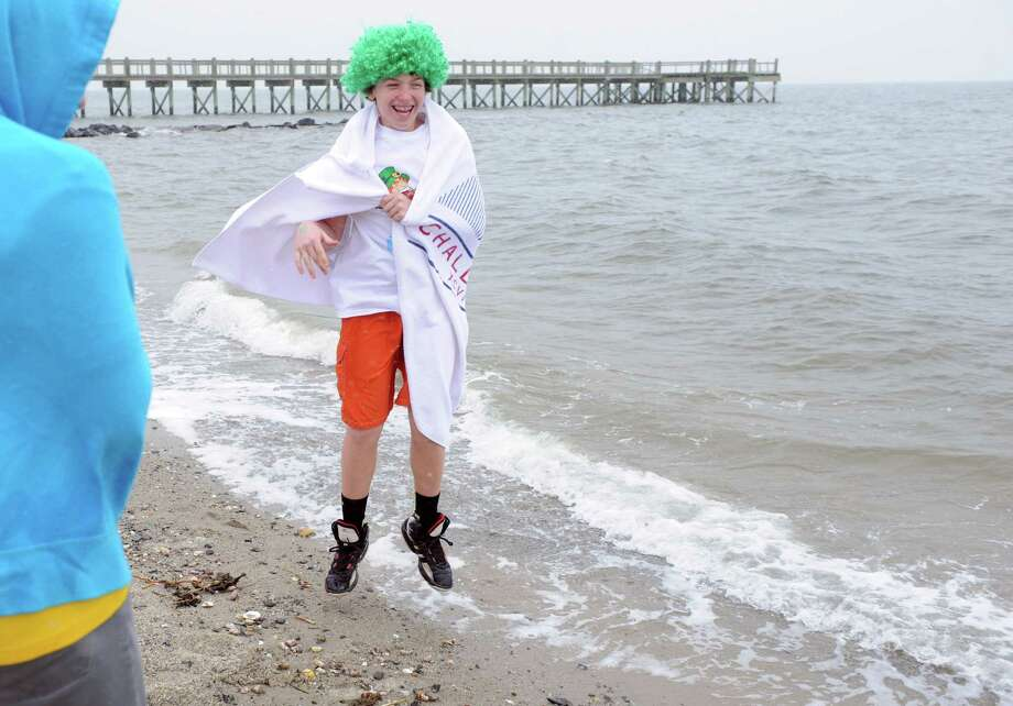 J.D. Anderson, 13, of Milford, tests the waters before the annual Leprechaun Leap to benefit the Literacy Center of Milford Saturday, Mar. 16, 2013 at Walnut Beach in Milford, Conn. Photo: Autumn Driscoll / Connecticut Post