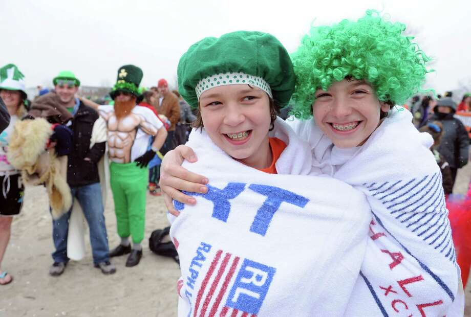 Friends Cole Egersheim, 13, of Milford, and J.D. Anderson, 13, of Milford, get ready for the annual Leprechaun Leap to benefit the Literacy Center of Milford Saturday, Mar. 16, 2013 at Walnut Beach in Milford, Conn. Photo: Autumn Driscoll / Connecticut Post