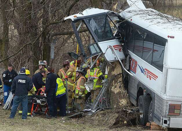 Emergency and rescue crews respond to a bus crash involving the Seton Hill University women's lacrosse team Saturday. Photo: Jason Malmont, Associated Press