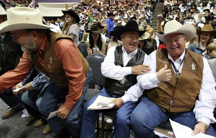 "Rico Flores congratulates one of his bidding partners, Roger Bethune after they bid $360,000 for  ""Chappie"" the Grand Champion Junior Market Steer shown by Kelton Long, 15, of Wellington, Texas, during the 2013 Junior Market Steer Auction at the Houston Livestock Show and Rodeo Saturday, March 16, 2013, in Houston. The buyers were Evelyn and Roger Bethune; Vanessa, Chris, Kyle and Rihanna Bruegger; Sally and Rigo Flores; and Stewart Title/Mary Alice and E.D. Lester. Photo: Karen Warren, Houston Chronicle / © 2013 Houston Chronicle"