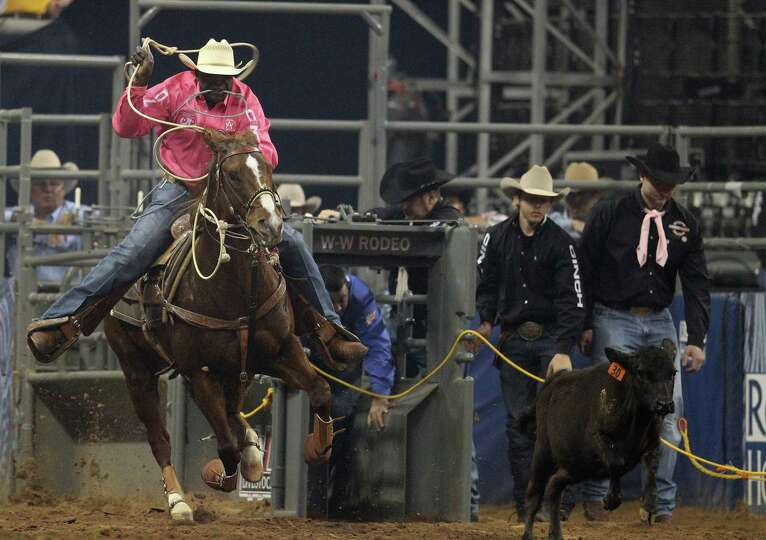 Fred Whitfield ropes during the tie-down to make it into the  final BP Super Series Championship at