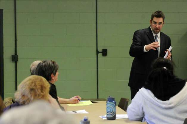David Barnett of GAR Associates, Inc. speaks during a educational meeting on the Troy reassessment on Saturday March 16, 2013 in Troy, N.Y. (Michael P. Farrell/Times Union) Photo: Michael P. Farrell