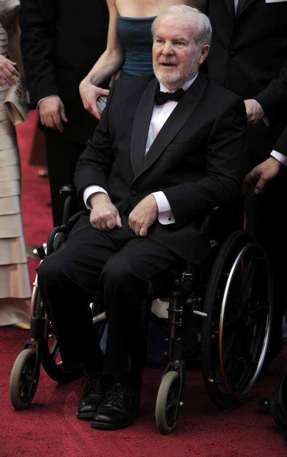 This March 7, 2010 file photo shows former Wash. Gov. Booth Gardner arriving at the 82nd Academy Awards in Los Angeles. Gardner died Friday, March 15, 2013, after a long battle with Parkinson's disease. He was 76.