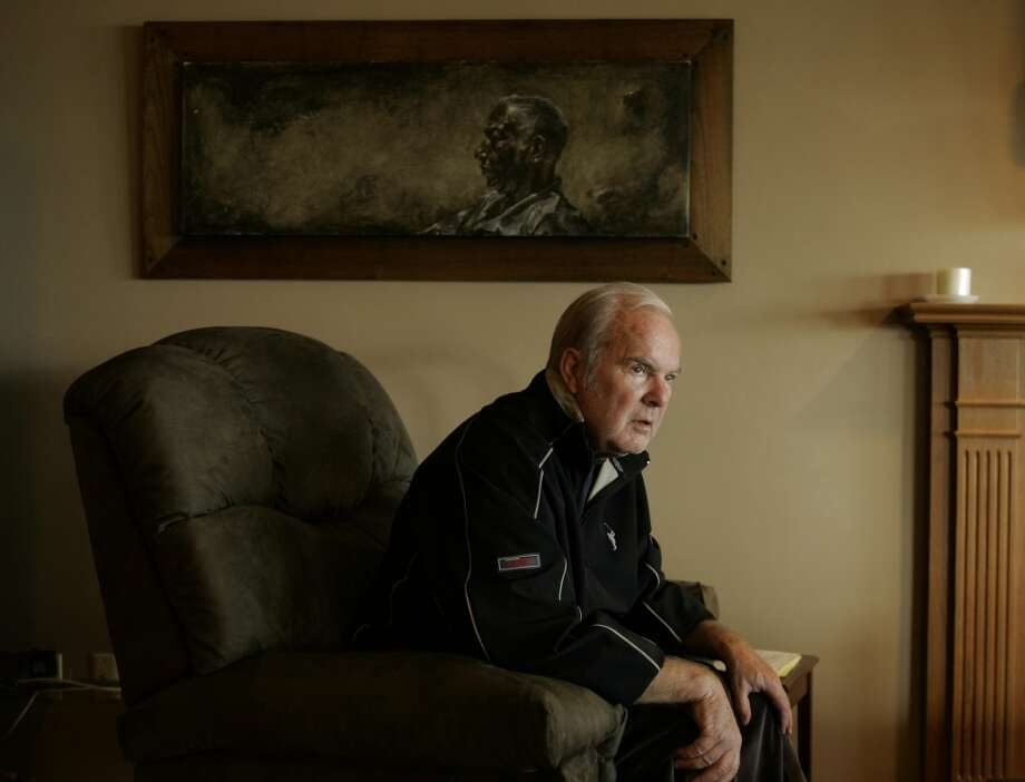 In this May 27, 2008 file photo, former Washington Gov. Booth Gardner, sits in his home in Tacoma.  Gardner, a two-term Democratic governor who later in life spearheaded a campaign that made Washington the second state in the country to legalize assisted suicide for the terminally ill, has died after a long battle with Parkinson's disease. He was 76.  Gardner died Friday, March 15, 2013 at his Tacoma home, family spokesman Ron Dotzauer said Saturday. He was the state's 19th governor.