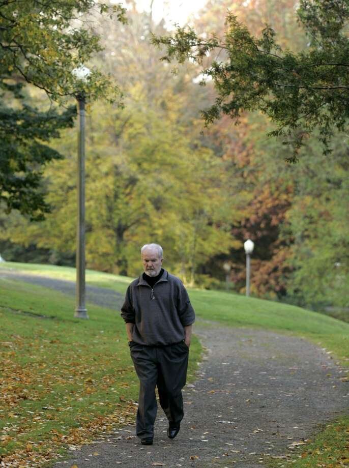 In this Oct. 25, 2006 file photo, Booth Gardner walks in Wright Park, near his home in Tacoma.