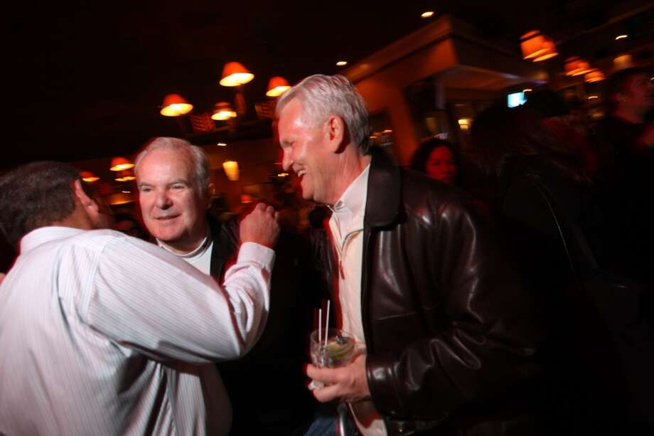 Former Washington Gov. Booth Gardner is greeted by Eli Stutsman (left) and Kirk Robinson (right), who helped him on the campaign I-1000 at the Rockbottom in Seattle on Nov. 4, 2008.