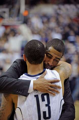 Connecticut coach Kevin Ollie hugs Shabazz Napier after his team's 63-59 overtime win against Providence in an NCAA college basketball game in Storrs, Conn., Saturday, March 9, 2013. (AP Photo/Fred Beckham) Photo: Fred Beckham, Associated Press / FR153656 AP