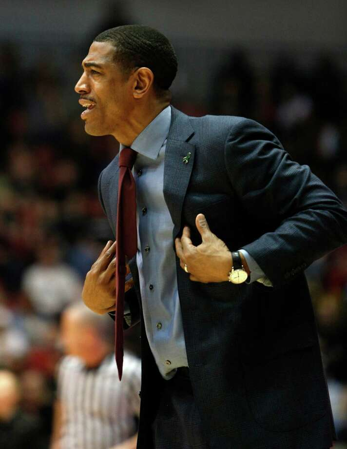 Connecticut  head coach Kevin Ollie reacts during the first half of an NCAA basketball game against Cincinnati, Saturday, March 2, 2013, in Cincinnati. (AP Photo/David Kohl) Photo: David Kohl, Associated Press / FR51830 AP