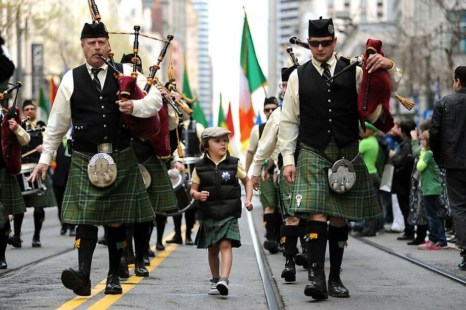 Sandy Sharpe, 5, marches with his dad Ian Sharp(R) who is part of the Irish Pipers Band of San Francisco, at the annual St. Patrick's Day Parade in San Francisco, Saturday March 16th, 2013. Photo: Michael Short, Special To The Chronicle