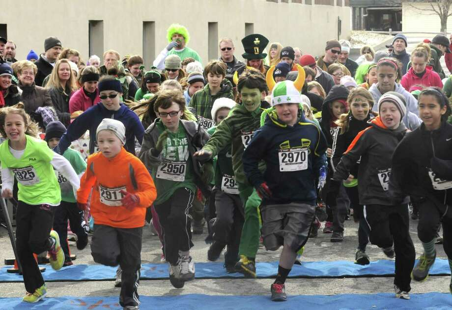 Children break fro the start of the kids run as part of the 2 Annual Great Kilt Race on Saturday March 16, 2013 in Averill Park, N.Y. (Michael P. Farrell/Times Union) Photo: Michael P. Farrell