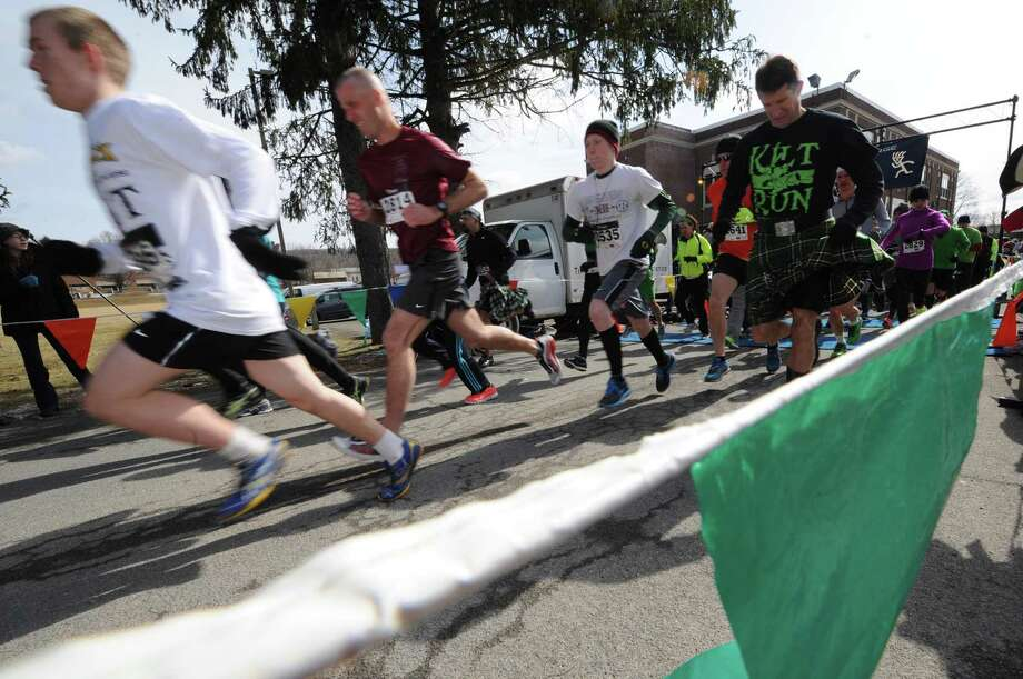 Runners break from the start during the 2 Annual Great Kilt Race on Saturday March 16, 2013 in Averill Park, N.Y. (Michael P. Farrell/Times Union) Photo: Michael P. Farrell