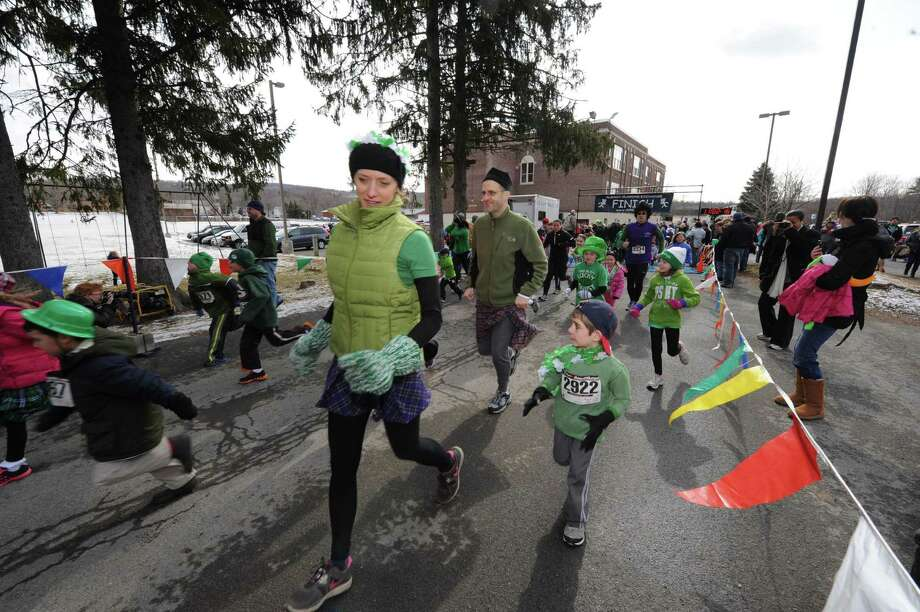 Parents and children break from the start of the kids run as part of the 2 Annual Great Kilt Race on Saturday March 16, 2013 in Averill Park, N.Y. (Michael P. Farrell/Times Union) Photo: Michael P. Farrell
