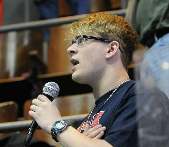 Nathaniel Hintz of Sacred Heart sings the National Anthem during the start of the State Open swimming championships at Yale University, New Haven, Conn., Saturday, March 16, 2013. Photo: Bob Luckey / Greenwich Time