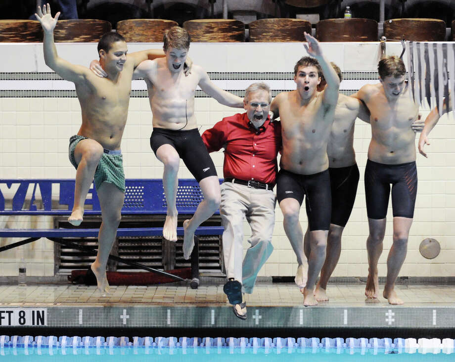 Greenwich High School swimming coach Terry Lowe, red shirt, gets thrown into the Yale Univeristy pool by his team after they won the State Open swimming championship at Yale in New Haven, Conn., Saturday, March 16, 2013. Photo: Bob Luckey / Greenwich Time