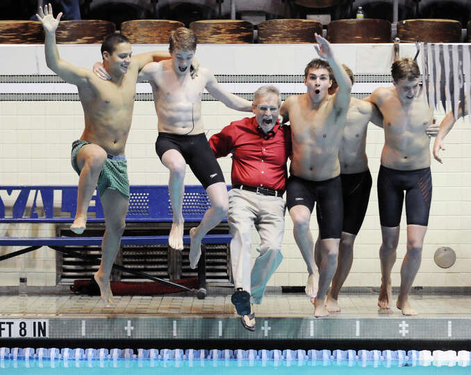 Greenwich High School swimming coach Terry Lowe, red shirt, gets thrown into the Yale Univeristy poo
